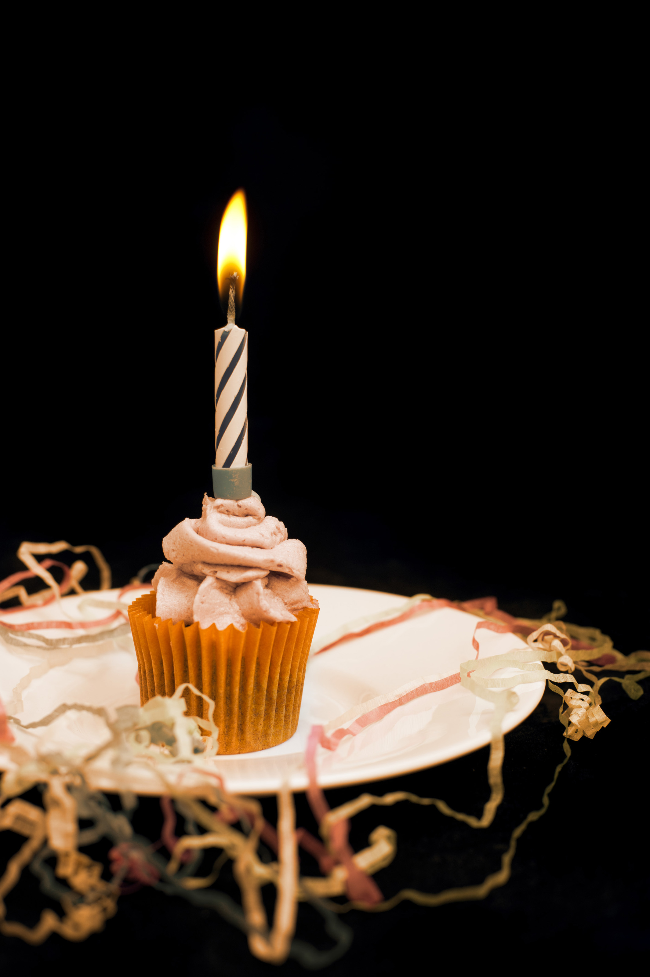 Burning candle on an orange cupcake-6076 | Stockarch Free ...