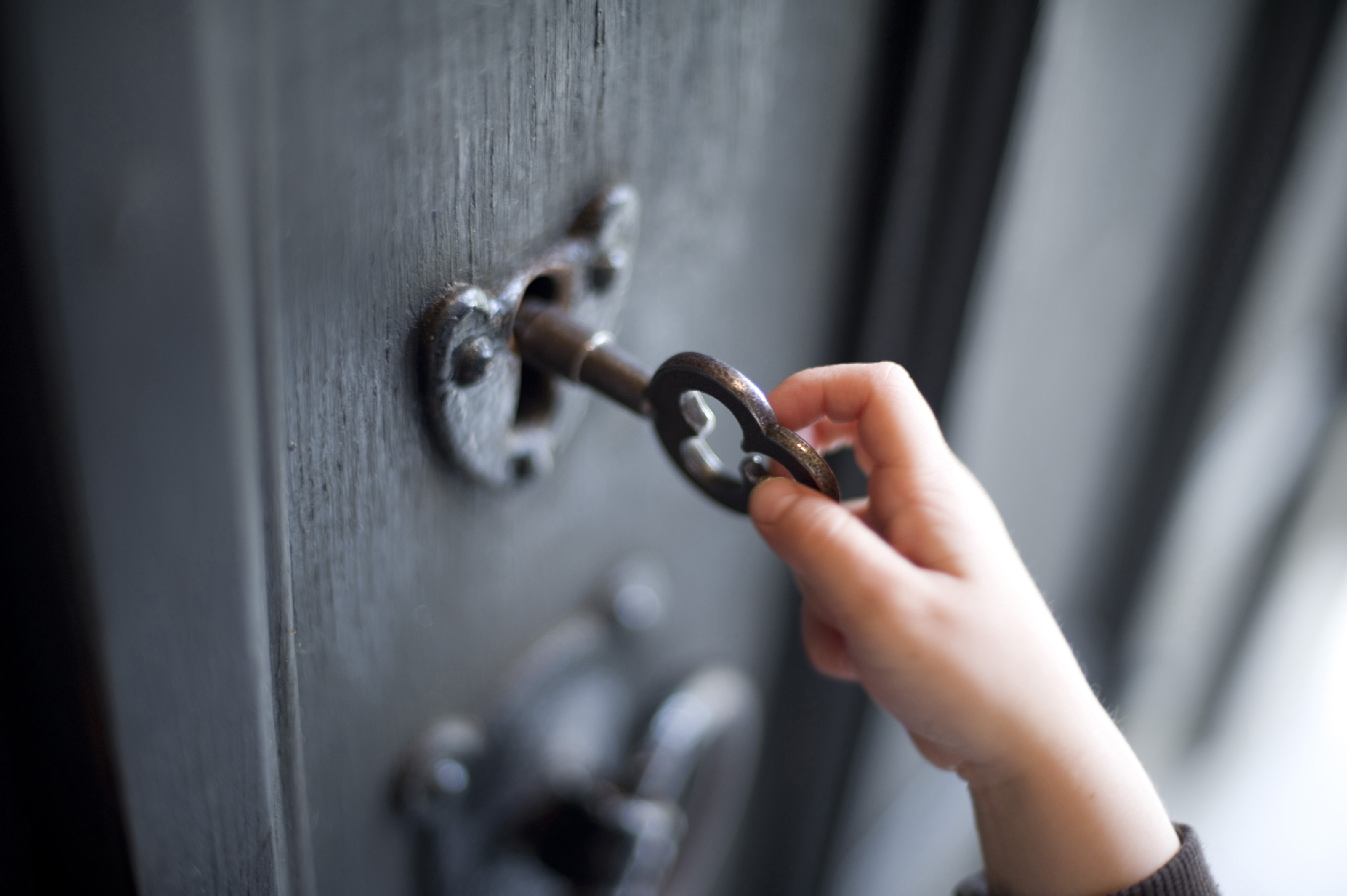 Accept License and Download Image & Young boy unlocking a door-7249 | Stockarch Free Stock Photos