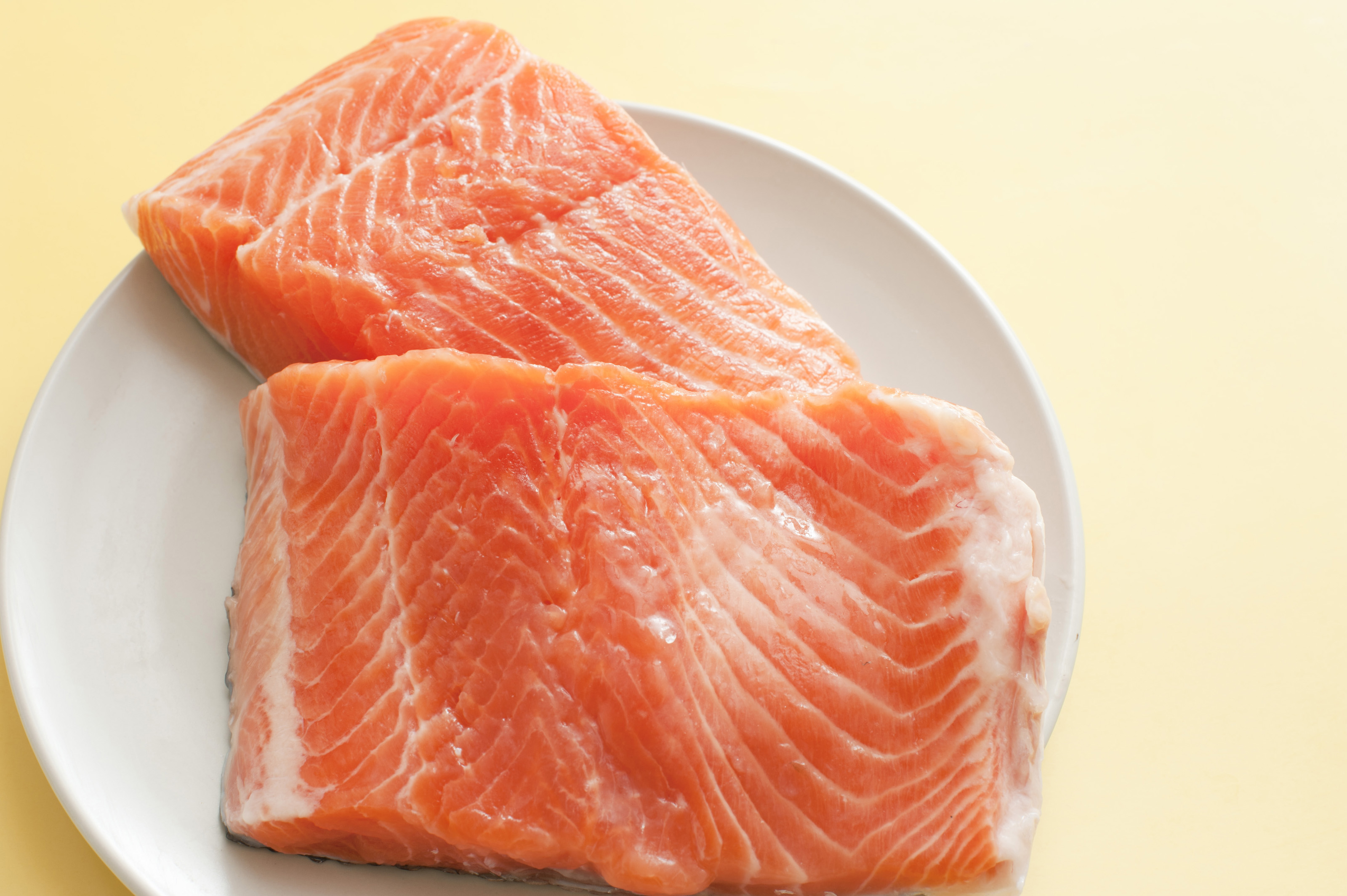Smoked salmon fish meat on white plate 8957 stockarch for Is fish meat