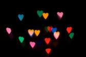 defocused camera effect creating valentine heart shapes
