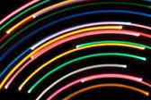 arcs of brightly coloured light