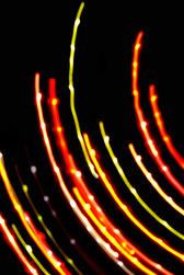 concentric curved red and green coloured lines of light with bright highlights