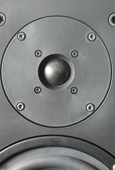 close up on the tweeter mouned in a hi-fi speaker cabinet