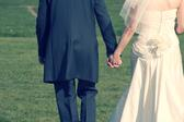 cross processed image of a wedding couple holding hands