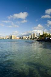 sunny day in a holiday paradise, waikiki beach honolulu, hawaii