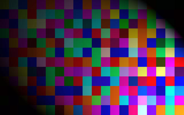 a grid of colurful squares under a spotlight effect