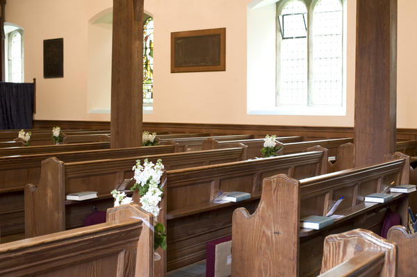 rows of traditional church pews in a small village church