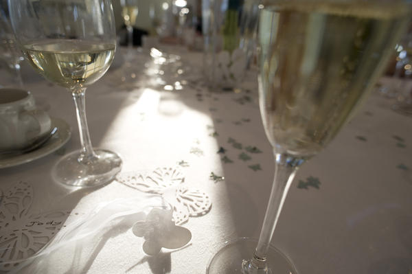 a wedding table and glass of champage ready for the wedding toast