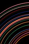 curved concentric lines of vivid coloured light