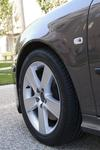 an alloy wheel on the front of a modern car