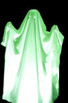 stock image Person dressed up as a scary green Halloween ghost or ghoul raising its arms in a frightening gesture