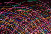 multicoloured crisscrossing curved lines of coloured light on a black background. I used this composition for my twitter background http:/twitter.com/Creativity103