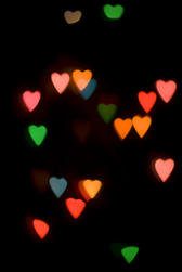 colourful bokeh light shape created using a cutout loveheart mask