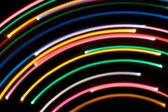 arcs of brightly coloured light