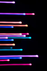 streaking lines of parallel purple and pink coloured light