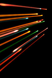 colourful lines of lite dissappearing towards a vanishing point