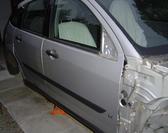 car door panels in a workshop