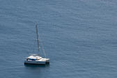 Luxury sailing catamaran moored offshore in mid ocean for a tropical vacation with copyspace