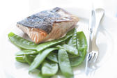Pan fried salmon steak served with succulant sugarsnap peas in their pods