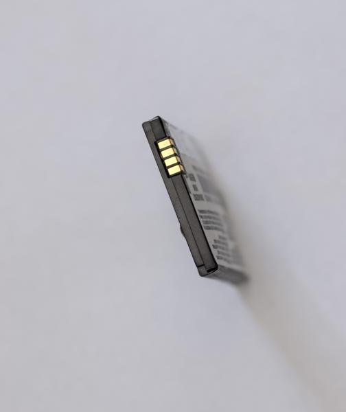 A defective cell phone lithium ion battery which has expanded out of shape