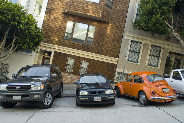 cars parked on one of san franciscos many steep hills photographed to create an unusual visual effect