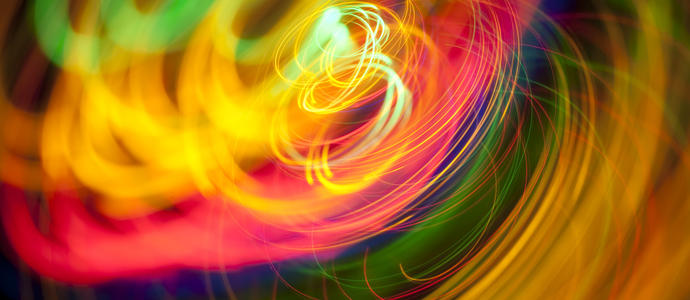 colourful background pattern of circular loops painted with multi coloured lights